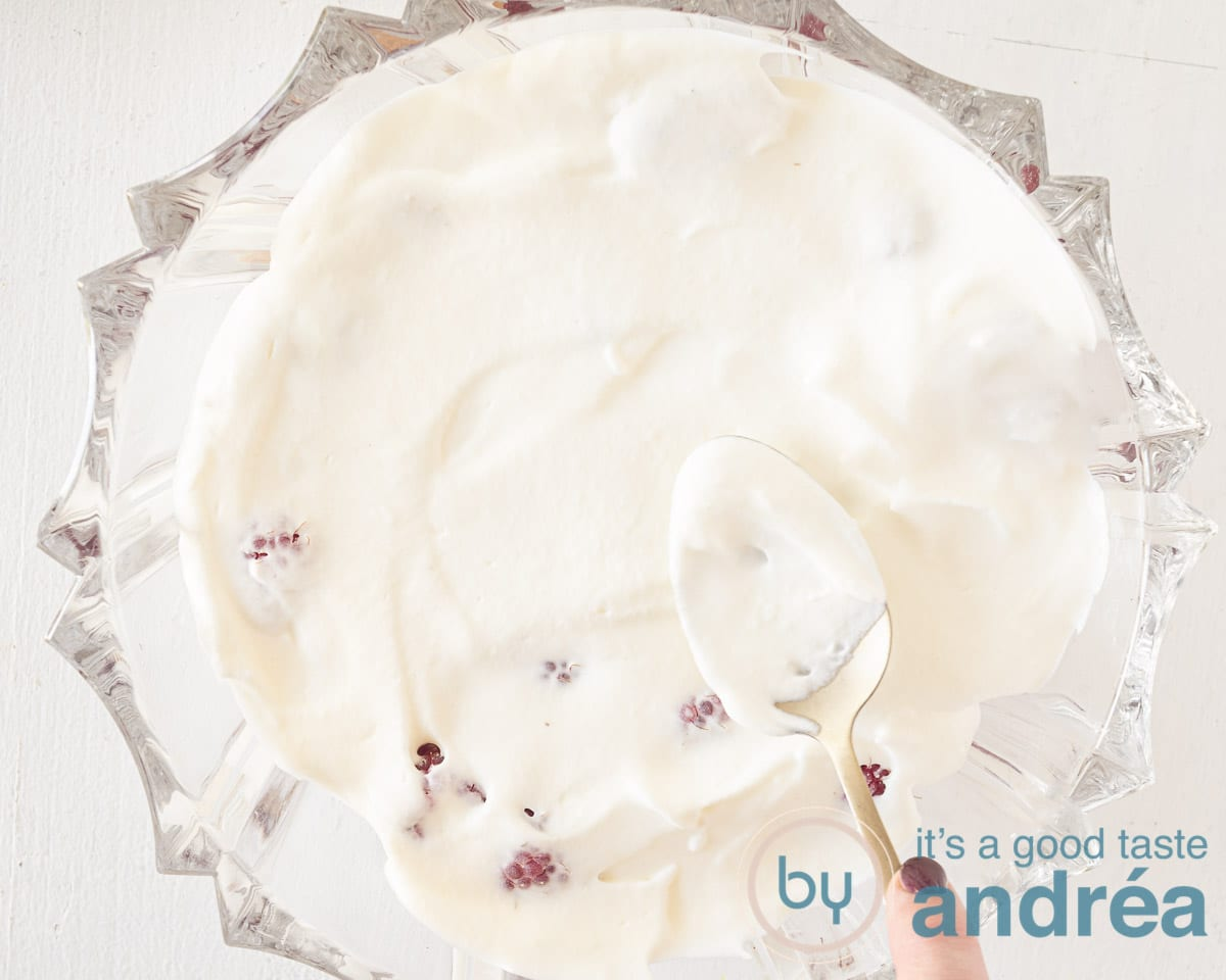 Cover the raspberries with a layer of vanilla whipped cream.