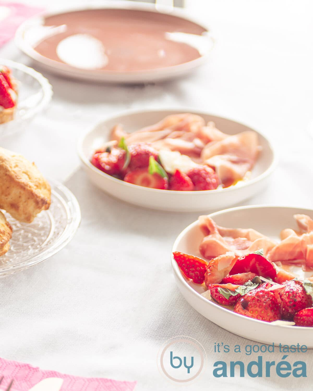 strawberries marinated in balsamic vinegar on a plate and some scones