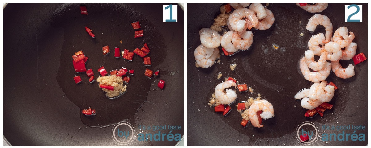 a frying pan with garlic and red pepper and shrimp that are fried.